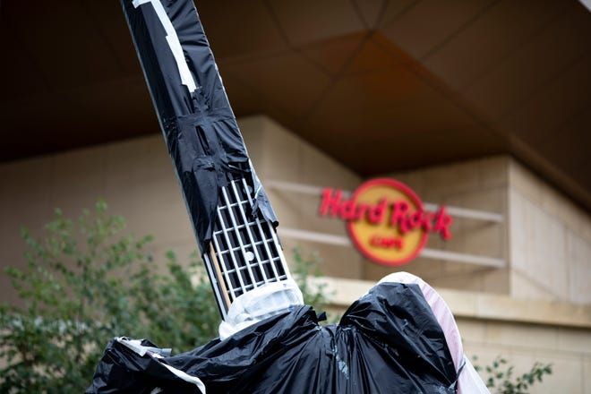 A view of the guitar outside the Hard Rock Cafe on Thursday, Oct. 7, 2021, in Cincinnati.