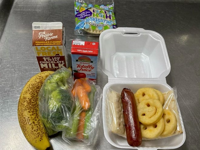 An example of a lunch meal for Montgomery County students during the COVID-19 pandemic:  a hot dog served with flatbread, a banana, carrots, broccoli, other sides and milk. (Photo courtesy by CMCSS)