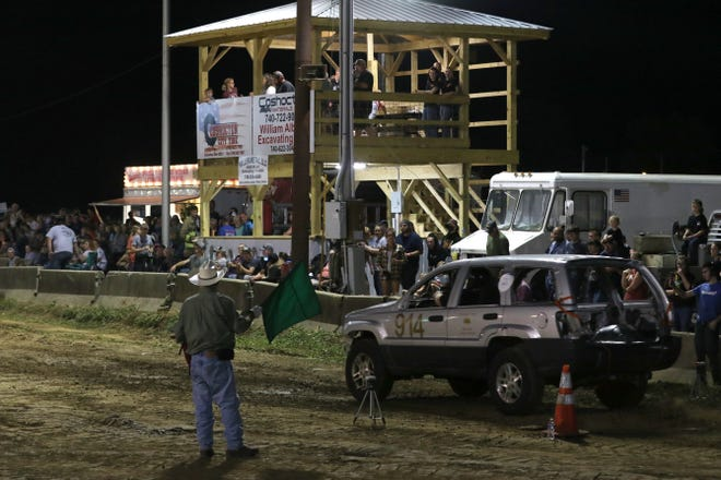 The new tower at the Coshocton County Fairgrounds track overlooks the start of a rough truck run Wednesday night.