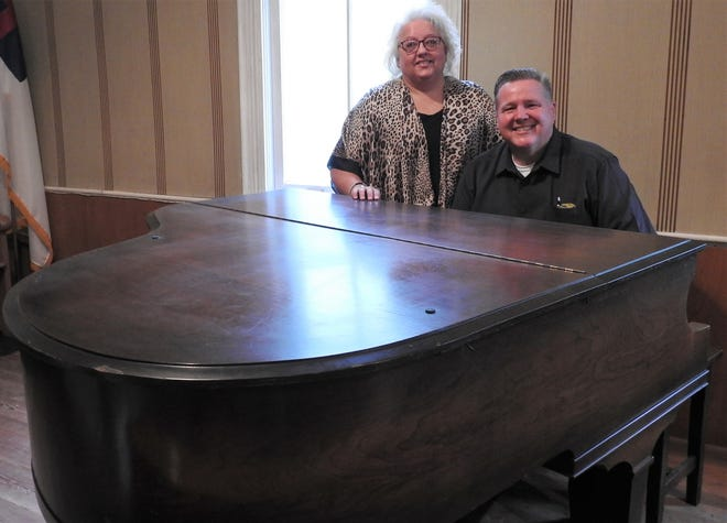 Tammy and Sheldon Mencer at the 100-year-old piano at the new Mission 3:16 Tyndall, in the old Tyndall United Methodist Church. Several concerts and special services are planned through the end of the year as remodeling continues.