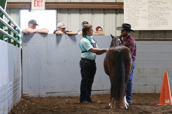 JD Herron works with horse judge Ethan Helmick during the Showman of Showmen competition at the Coshocton County Fair on Wednesday. Herron, of Go Getters 4-H Club was named the best of the showman of showmen.