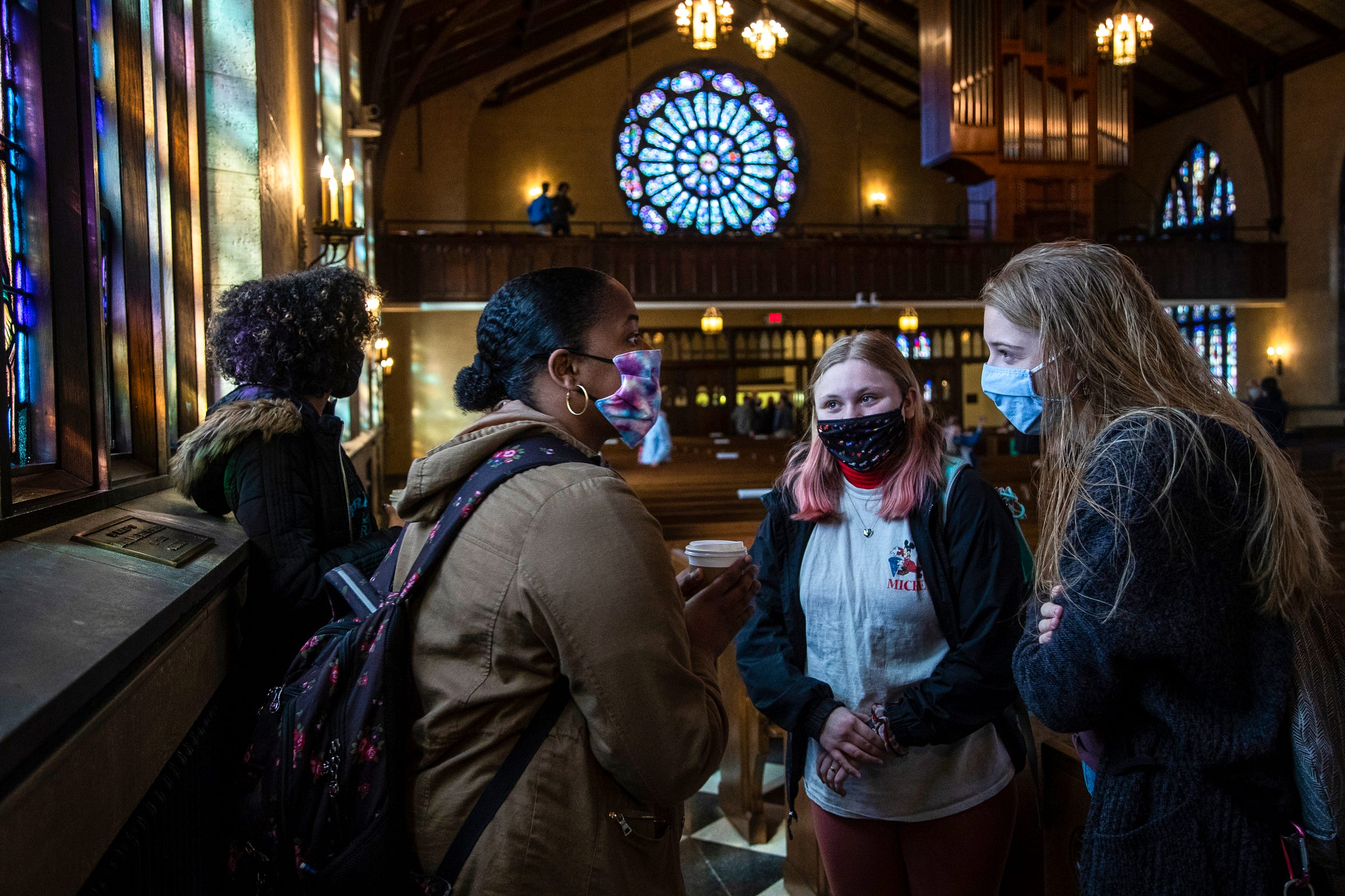 Hope College sophomore student Trinity Frye, center left, talks to Kate Kalthoff, center right, and Brianna Tomczak, both freshmen, after the 10:30 a.m. worship service at the Dimnent Memorial Chapel on Hope College campus in Holland, Wednesday, March 31, 2021.