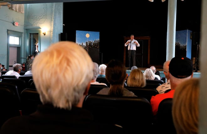 Tim Ryan, the US Representative for Ohio's 13th District, speaks to a crowd in Baltimore's Victoria Opera House Thursday, Oct. 7. He discussed improving America's, and specifically Ohio's, infrastructure and focusing on improving industry to secure America's future.
