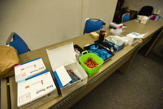 New syringes and other medical supplies seen on tables at Lansing Syringe Access at 913 W. Holmes in Lansing.