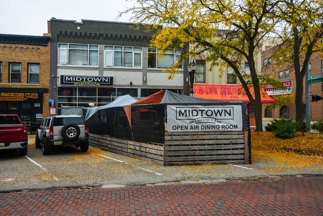 The makeshift open air dining room outside of Midtown Brewing Company in downtown Lansing, pictured Thursday, Oct. 7, 2021.