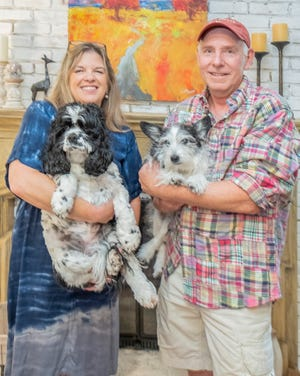 Kristi and KenBauer, and their canine companions Gracie-Faye and Chewie, love their new home.