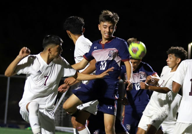 Senior midfielder Bryan Madrid (10) was active in the box for the Wildcats and kept pressure on the Panthers in front of the goal.
