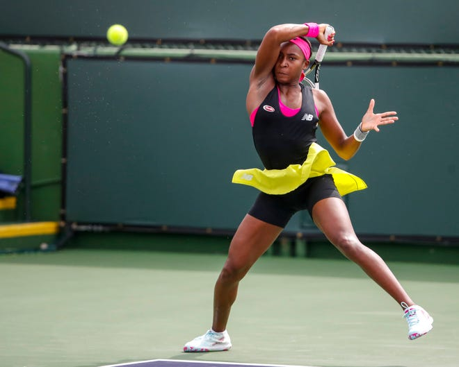 Coco Gauff hits a forehand while playing with partner Leylah Fernandez during their first-round doubles match at the BNP Paribas Open in Indian Wells, California on Oct. 7, 2021.