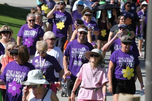 Walkers participate in the Walk to End Alzheimer's at Palm Desert Civic Center Park in Palm Desert on Saturday, March 14, 2015.