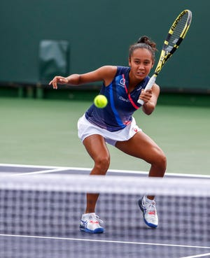 Leylah Fernandez hits a volley while playing with partner Coco Gauff during their first-round doubles match at the BNP Paribas Open in Indian Wells, California on Oct. 7, 2021.