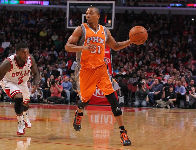 Sebastian Telfair makes his way around Nate Robinson during his time with the Phoenix Suns.