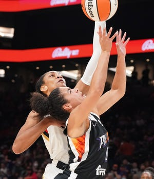 Phoenix Mercury's Kia Nurse (0) goes up for a shot against the Las Vegas Aces A'ja Wilson (22) during the first half of their game at Footprint Center Oct, 6, 2021 in Phoenix.