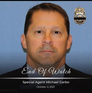 DEA special agent Michael Garbo died Oct.. 4, 2021, after a man opened fire in an Amtrak train in Tucson.
