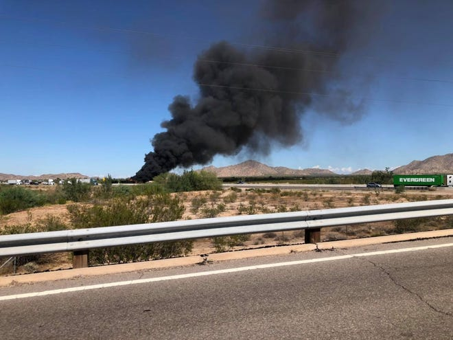 A column of black smoke is visible from a multiple-vehicle crash near Casa Grande on Oct. 6, 2021.