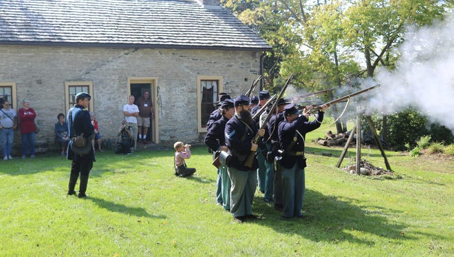 The 14th Ohio Volunteer Infantry re-enactors fire off their muzzle-loading rifles outside of the historical Civil War encampment at the Wolcott House during the Lakeside-Marblehead Lighthouse Festival in 2017. It is one of many activities set to return as part of this year's festival on Saturday.