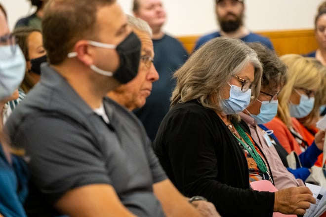 Dr. Annette Mercatante, right, listens to public comment during a board of commissioners meeting Thursday, Oct. 7, 2021, in Port Huron. Last month, Mercatante, St Clair County's medical health officer, was asked to rescind a public health order. She didn't, but it was subsequently two weeks later.