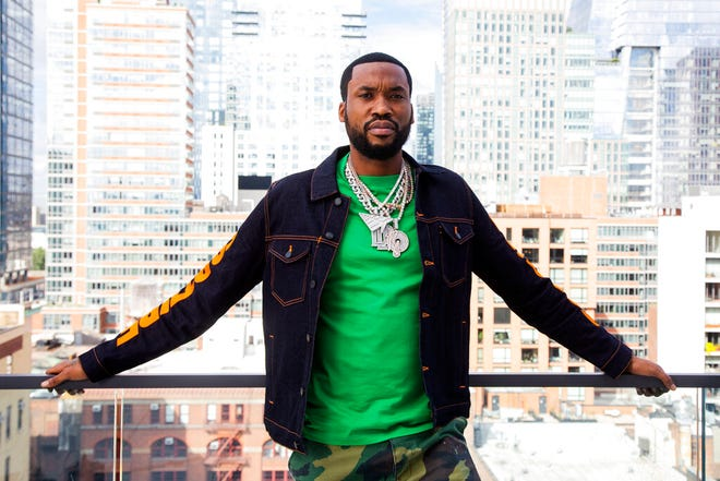 """Meek Mill poses for a portrait at the Roc Nation offices in New York on Sept. 22, 2021, to promote his upcoming album """"Expensive Pain."""" The Philadelphia rapper is planning a concert on Oct. 23 at Madison Square Garden to celebrate the new album. (Photo by Andy Kropa/Invision/AP)"""