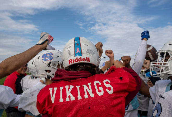 North Salinas High School varsity football team huddles during an afternoon practice in Salinas, Calif., on Wednesday, Oct. 6, 2021.