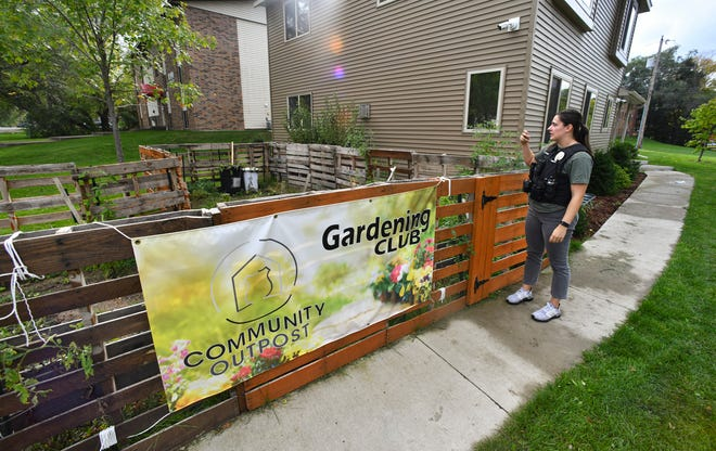 St. Cloud police officer Taylor Richmond talks about the success of the community garden planted  near the COP House Thursday, Oct. 7, 2021, in St. Cloud..
