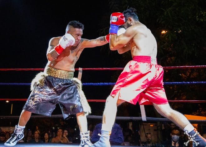 Robert Ortiz Jr. (left) throws a left in his fight against Mario Aguirre during the Heroes Among Us boxing show at the Simi Valley Town Center on Oct. 2. The bout ended in a draw.