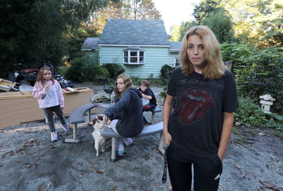 Jessica Rose at her Haverstraw house with her children Madilyn, 7, Meadow, 15, and Masin, 8, Oct. 7, 2021. They have been living in motels since the house was deemed unsafe after flooding damage from the remnants of hurricane Ida.