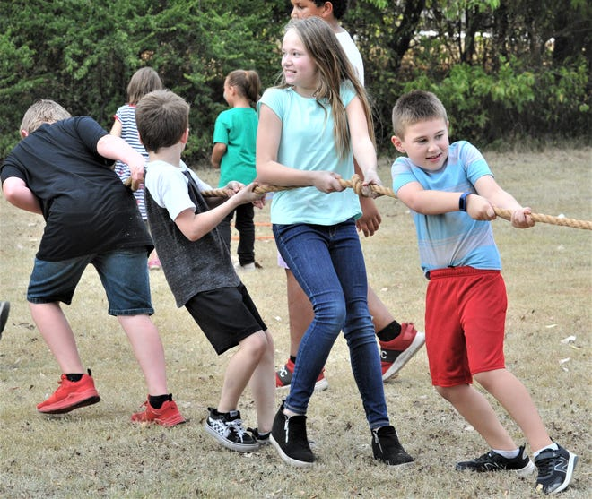 """Boys and girls played tug-o-war during the Campfire Boys and Girls """"Fall Family Fun Night"""" at Harrell Park on Thursday, October 7, 2021."""