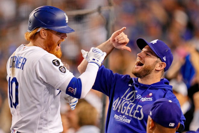 NL wild card: Dodgers third baseman Justin Turner celebrates with Max Muncy after hitting a home run.