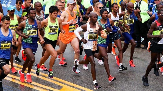 Apr 15, 2019; Boston, MA, USA; Geoffrey Kirui (NED) runs in the pack at the Boston Marathon starting line.