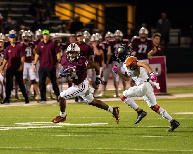 Trayvian McCoy-Gay, left, gets loose on a run, pursued by Hutto's Jose Pina. Round Rock won a District 25-6A football game at home over Hutto 41-12 on Oct. 7.