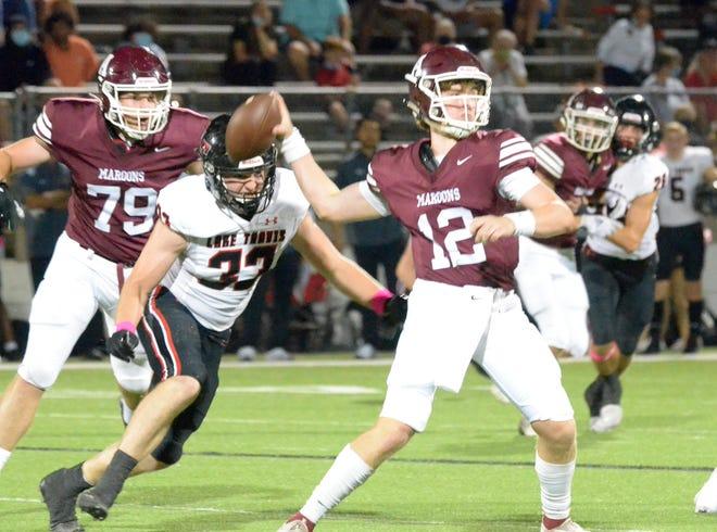 Lake Travis defensive end Max Linhoff, left, closes in on Austin High quarterback Wilder Davenport's blind side after getting past Josh Peterson (No. 79) in the first quarter of Thursday's game at House Park. Linhoff and Lake Travis rolled past Austin High 63-3.