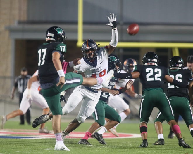 Glenn's Tendai Chirebvu reaches to block a Connally punt during the Grizzlies' 31-0 win Thursday at The Pfield.