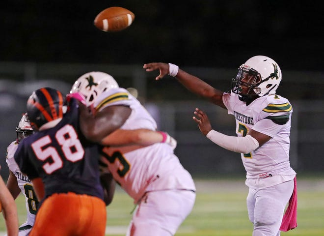 Firestone quarterback Prince Winchester makes a pass during the first half of a football game against Ellet, Thursday, Oct. 7, 2021, in Akron, Ohio.