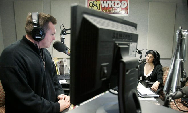 A Beacon Journal file photo shows Angela Bellios (right) in studio with Matt Patrick on the WKDD morning show in 2007.