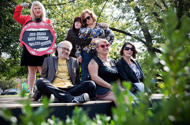 Nikki Wonder, middle back row, and other organizers of this weekend's She Burns Bright Festival photographed on the festival stage on Tuesday, October 5, 2021.