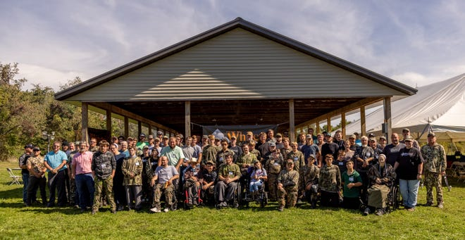 Hunters and volunteers pose for a photo before heading out for the Whitetail Heritage of Ohio youth hunt on Oct. 2 in Coshocton County.