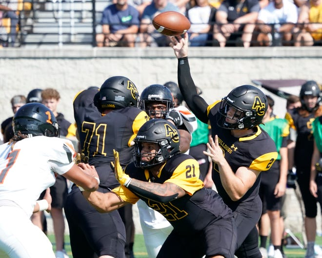 Adrian College quarterback Jack Wurzer throws a pass during a game against Greenville in 2021. [Telegram photo by MIke Dickie]