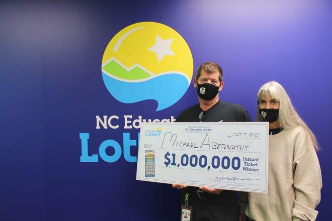 Michael Abernathy of Lexington and his wife, Lou Ann, celebrate their $1 million win.