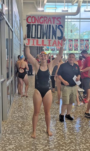 Coldwater swimmer Jillian McKinley, shown here celebrating her 100th career win as a Cardinal, was voted this week by the readers as The Daily Reporter Athlete of the Week.