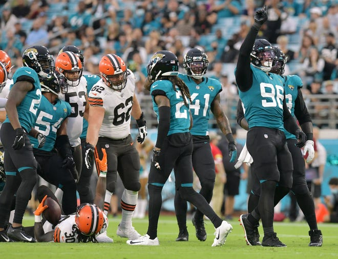 Jacksonville Jaguars defensive end Adam Gotsis (96) celebrates a tackle on Cleveland Browns running back D'Ernest Johnson (30) during early game action. The Jacksonville Jaguars hosted the Cleveland Browns for their only home preseason game at TIAA Bank Field in Jacksonville, Florida Saturday night, August 14, 2021. The Browns led at the half 13 to 0.  [Bob Self/Florida Times-Union]