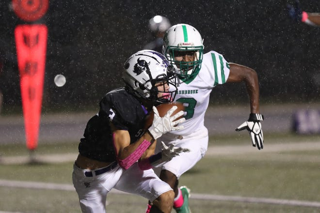 Stuart Cramer's Dameian Bentley hauls in a touchdown pass from Justin Rocquemore against Ashbrook Thursday night. The Storm defeated the Greenwave 31-20. (Brian Mayhew for the Gaston Gazette)