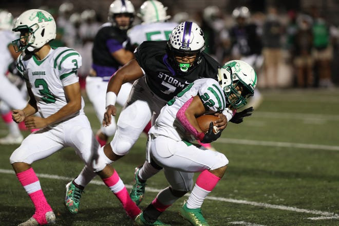 Stuart Cramer's Arias Nash brings down an Ashbrook ball carrier Thursday night in Belmont. The Storm defeated the Greenwave 31-20. (Brian Mayhew for the Gaston Gazette)