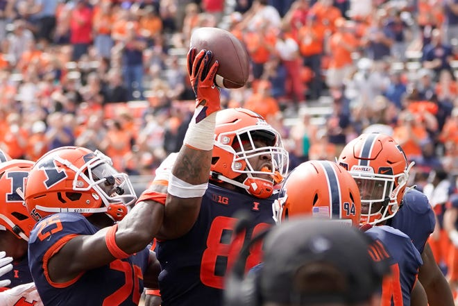 Illinois defensive lineman Keith Randolph Jr. (88) celebrates his interception of a pass by Charlotte quarterback Chris Reynolds during the second half of a game on Saturday, Oct. 2, 2021, in Champaign. Illinois won 24-14.