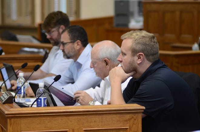 Ascension Parish Council members listen to a speaker during the Oct. 7 meeting at the courthouse in Donaldsonville. Shown from left are Aaron Lawler, Dal Waguespack, John Cagnolatti, and Michael Mason.