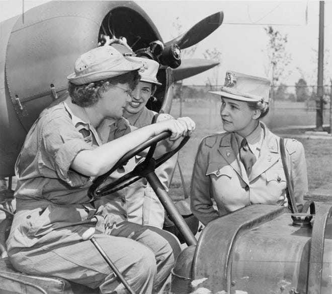 Col. Oveta Culp Hobby (right) talks with Auxiliary Margaret Peterson and Capt. Elizabeth Gilbert at Mitchel Field
