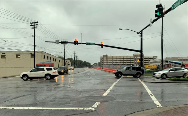 Weather permitting, North Daniel Morgan between St. John and Magnolia streets will be closed Saturday for line painting, then reopen Sunday with two lanes, while two lanes remain closed for construction of the new courthouse.