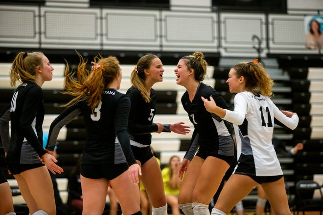 The West Ottawa varsity volleyball team celebrates after a score during a game against Jenison Thursday, Oct. 7, 2021, at West Ottawa High School.