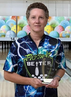 Flat Rock's Tracy Calfee poses with her N.C. Female Bowler of the Year award recently at Tarheel Lanes.