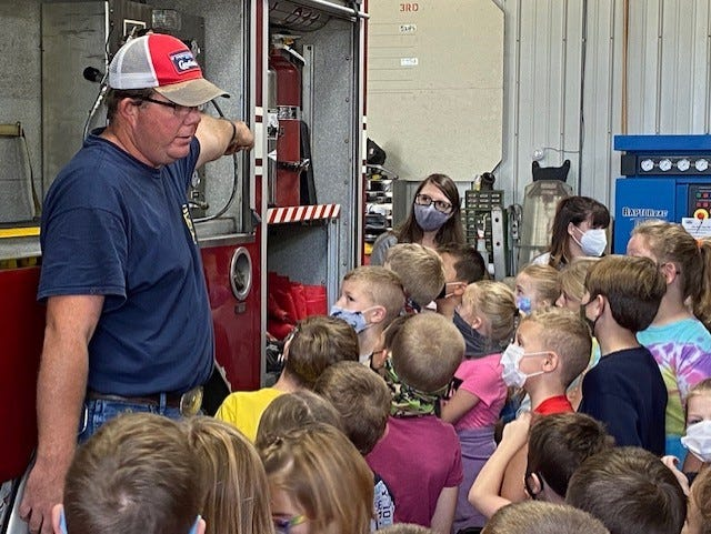 Assistant Fire Chief of Middletown Fire Cody Peddicord tells students of New Holland-Middletown Elementary what all the compartments are used for on a fire truck Friday in Middletown. Students took the day to honor all  First Responders including Logan County Dispatchers and Deputies as well as Firefighters from both New Holland and Middletown. Students also were treated to seeing a medical helicopter land on the school ball field.