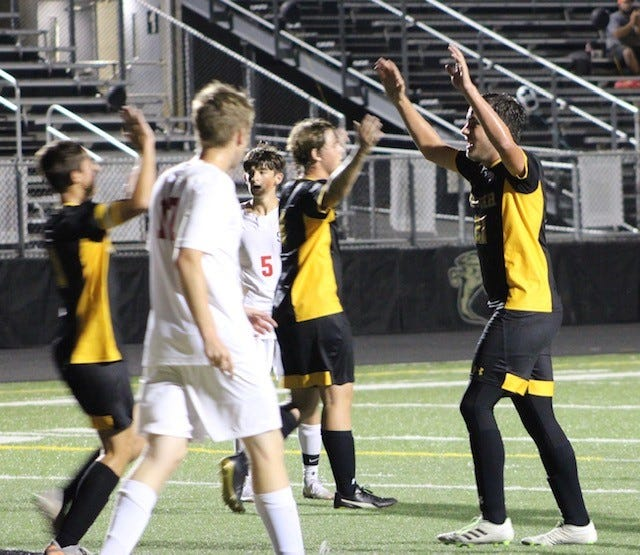 Keyser's Bryson Bush (right) celebrates with teammates after scoring a goal in the first half against Southern.