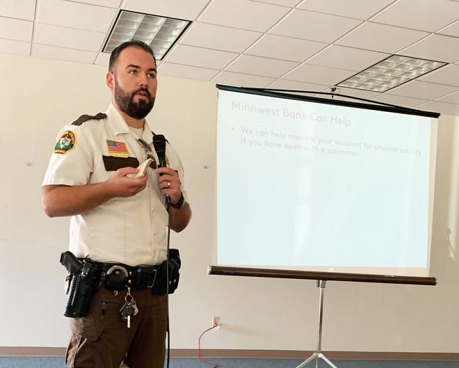 Chippewa County Sheriff Derek Olson speaks at the Safe Banking for Seniors seminar last week.